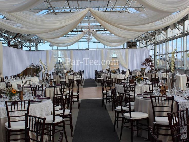 Lace Wedding Featuring Custom Ceiling Drapery and Chiavari Chairs