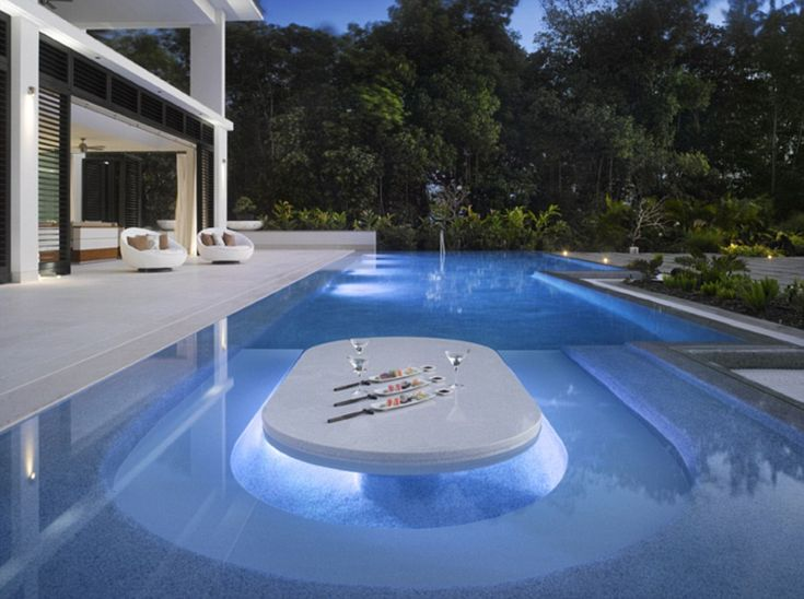 The incredible property even has a dining table inside a swimming pool, for when the hot w...