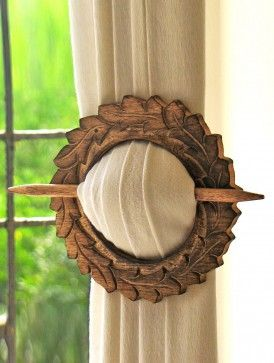 Wooden Curtain Holder. I love this, however, I would blunt the ends. Don't need any spearing themselves on the drapes.