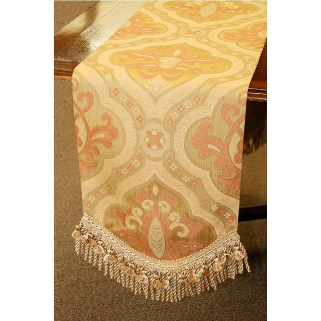 Woven by master weavers, this table runner features a hand-tied fringe and tassels. A lovely rose and camel colored transitional design finishes this table runner.