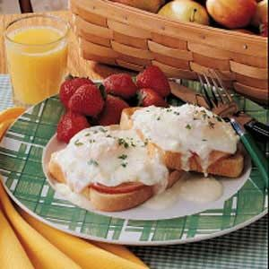 Sunday Brunch Eggs Recipe -This recipe is special enough to consider when company comes, and it's a convenient way to serve eggs to a group. Nestled on top of Canadian bacon and Swiss cheese, the eggs are drizzled with rich cream. For a pretty presentation, cut around each egg and serve on toast.          —Judy Wells                                                                Phoenix, Arizona