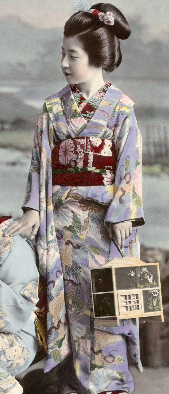 Hunting Fireflies by Kajima Seibei 1897. This black and white photograph of threehangyoku (young geisha) from the Shinbashi geisha district of Tokyo hunting fireflies, was taken in 1897 by Kajima...