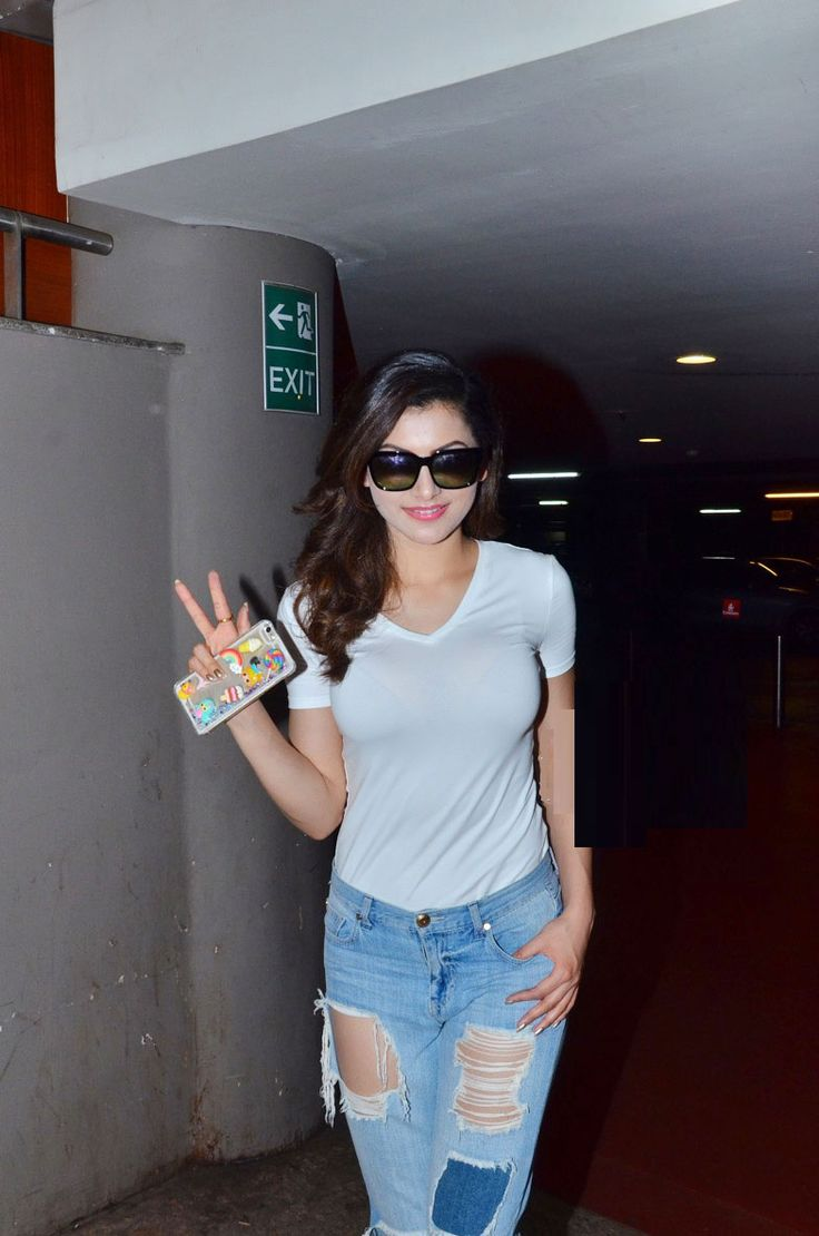 Urvashi Rautela in a very hot ripped / shredded jeans and sexy white top. - Bollywood Reporter