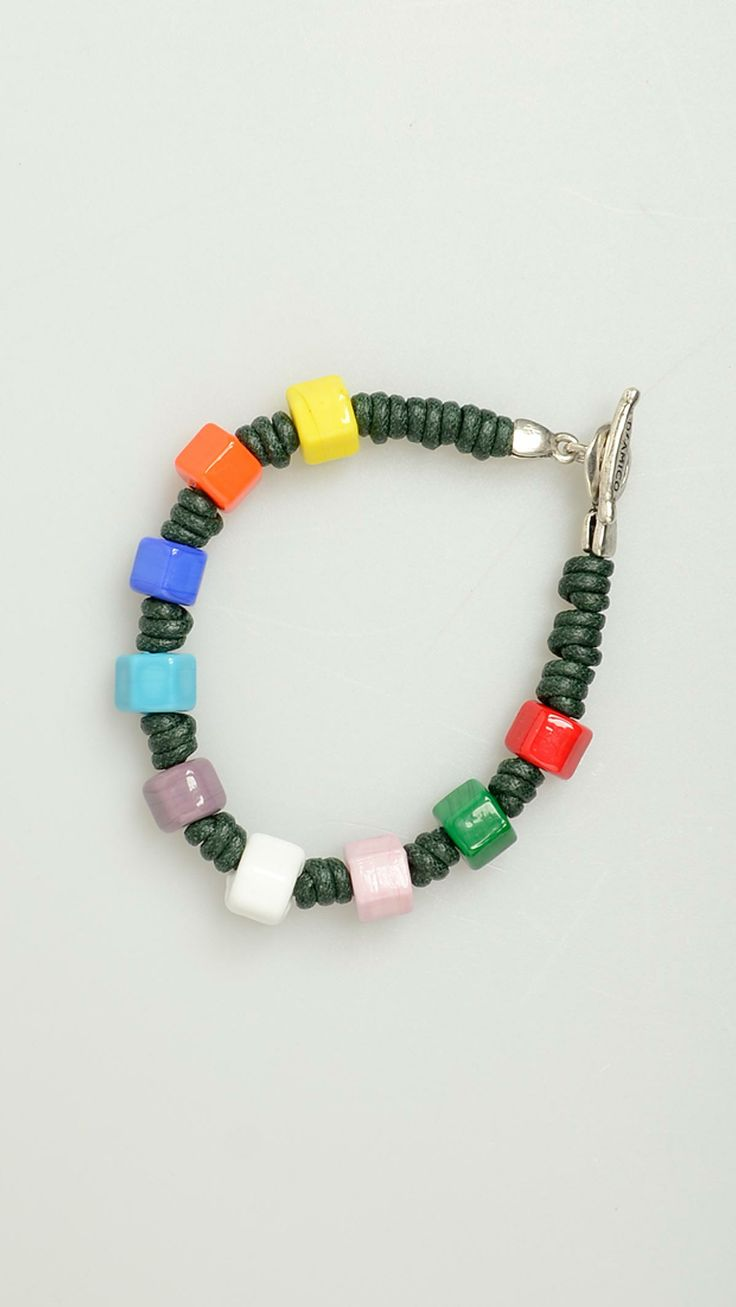 Andrea D'Amico. Green wire waxed cotton bracelet, featuring multicolour glass bolts, T-bar closure