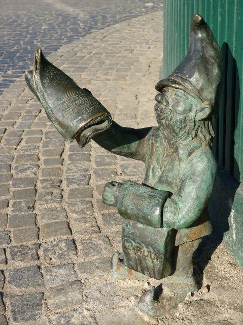 A gnome selling newspapers in Wroclaw