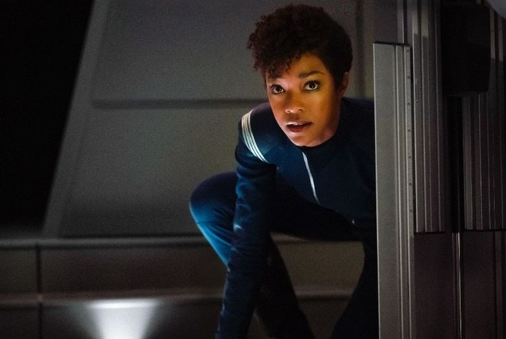 Star Trek Discovery beams new trailer at San Diego Comic-Con   More details about the new CBS series Star Trek: Discovery surfaced during their panel and press conference on Saturday during San Diego Comic-Con. The audience was treated to a new trailer which was released after the panel that very day.  In the trailer we hear an introduction from First Officer Michael Burnham (Sonequa Martin-Green): All life is born from chaos. The world doesnt always adhere to logic. Sometimes down is up and…