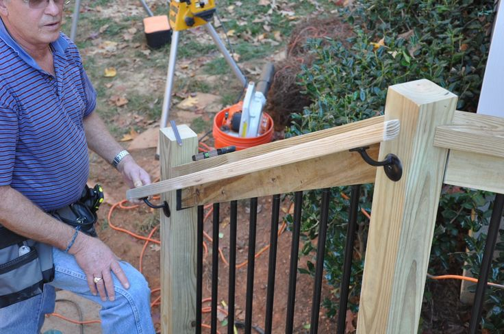 Step by step instructions for how to install deck stair railings.  Learn about the code requirements and construction tips with images.