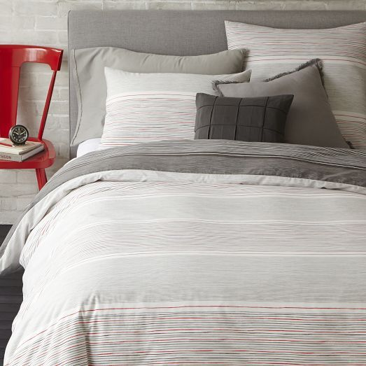 NEW! The reversible Skinny Mini Stripe Duvet Cover + Shams mixes light and dark stripes. Pair it with crisp white sheets and solid accent pillows for a classic look.