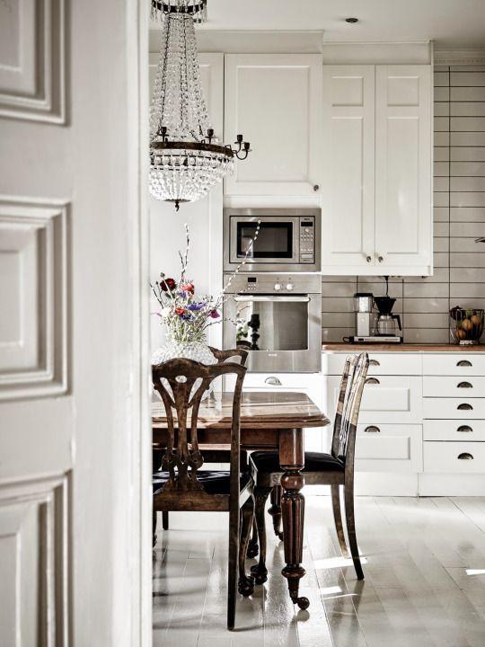 modern kitchen, antique dining set, chandelier