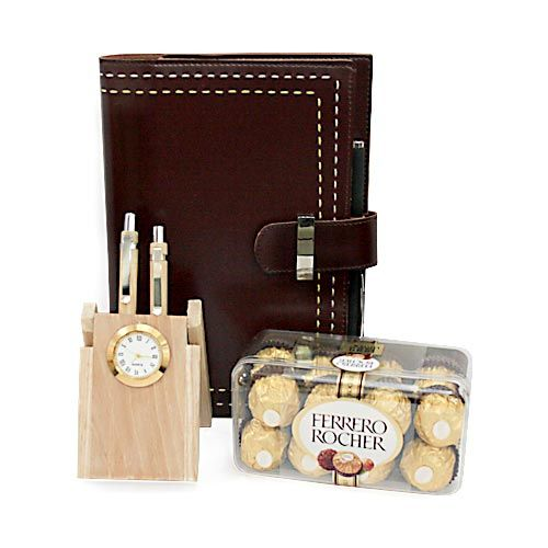 Sort out desktop space for your dear ones with the right accessories available with ferns n petals. Ferns n Petals bring an exclusive gift hamper range just for him. Grab a gift hamper of wooden pen holder with 2 pens and inbuilt watch of 7 inches, 10X8 inch folder and a box of 16 Ferero Rocher chocolates. With this hamper his work space will look lot better than before and will also help him to work efficiently. http://www.fnp.com/valentine/