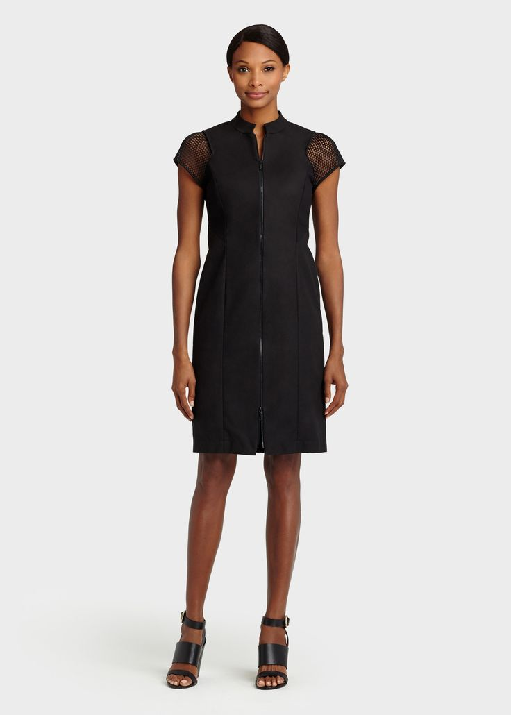 The black Brenda dress from Lafayette 148 NY features a cap beehive sleeve, stand up collar and 2 way zip front.