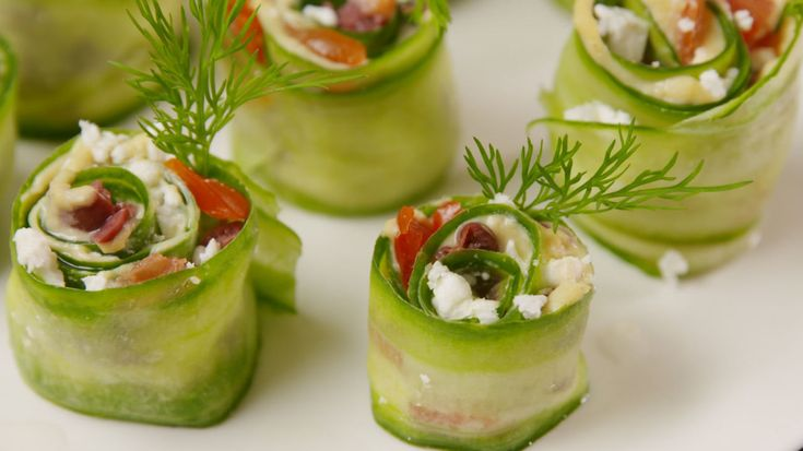Use cream cheese and salami with the tomatoes and olives Greek Sushi  - Delish.com