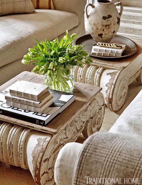 The room's neoclassical bent is articulated by Ionic capital coffee tables from RH.