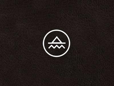 logo the ocean meets the mountains