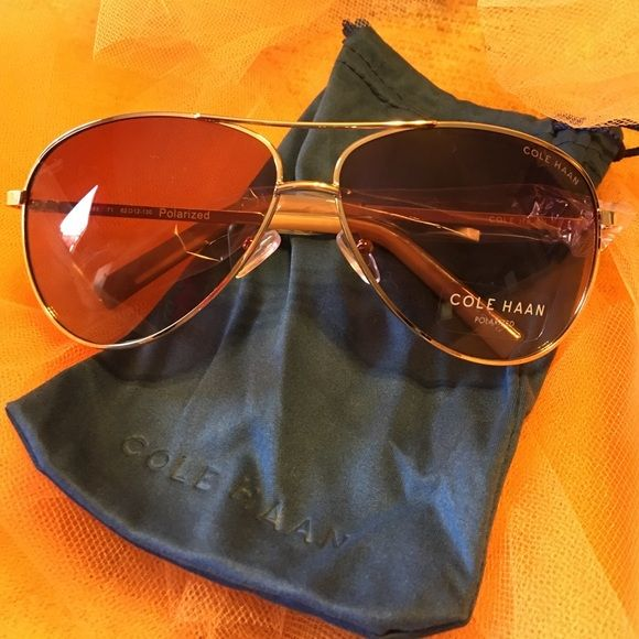 NWT Cole Haan rose gold aviator sunglasses. NWT Cole Haan aviator sunglasses. Rose gold. Polarized. Comes with drawstring sunglasses bag. Beautiful and stylish!  Brand new!  Never worn! Cole Haan Accessories Sunglasses