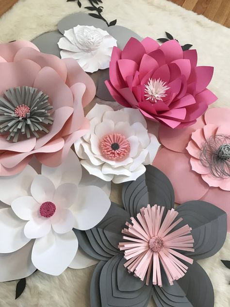 This set is perfect for your party decor, wedding decor, or living decor. This 7 piece set includes flowers ranging from 18 to 10. If you are near the Chicagoland area, please send me a message before purchasing so we can avoid shipping costs. *****LEAVES INCLUDED***** Customize your order by including the colors you would like for each flower in the note section to seller! *****I will keep in contact throughout the process with the buyer to make sure there is an agreement on colors an...