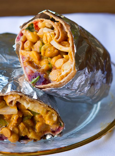 BBQ Cranberry Chickpea Wrap - The tangy sweet cranberry sauce, rustic BBQ chickpeas with sticky sweet, spicy bold flavor, crunchy sweet onions and a few more surprises all rolled into this healthy, delicious whole wheat wrap. A perfect lunchtime indulgence to energize your busy day. So easy you can whip this wrap up from start to finish in under ten minutes.