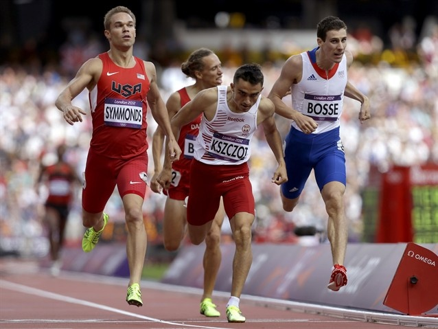 United States' Nick Symmonds, left, Poland's Adam Kszczot, center, and France's Pierre-Ambroise Bosse, right, compete in a men's 800-meter heat.