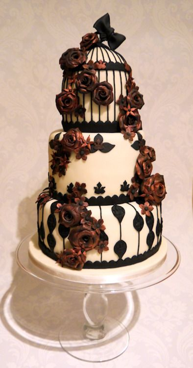 I like how a lot of people combine Gothic and Victorian to make a very nice looking cake. This is my favorite because the redness of the flowers doesn't over power the cake. It's fun to see how people have put their own little twist on the classic styles and even integrated them together. #APEUROVICTORIA