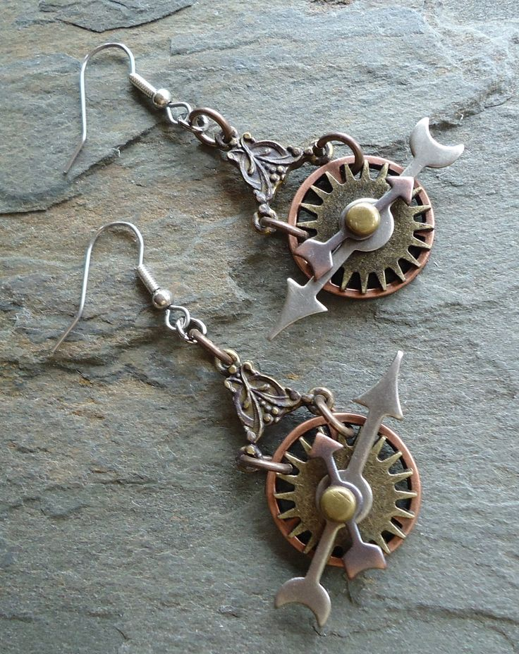 Earrings | Susan Jensen. A combination of timepiece components in various metals (antique brass, copper, and gunmetal) on sterling silver ear hooks.