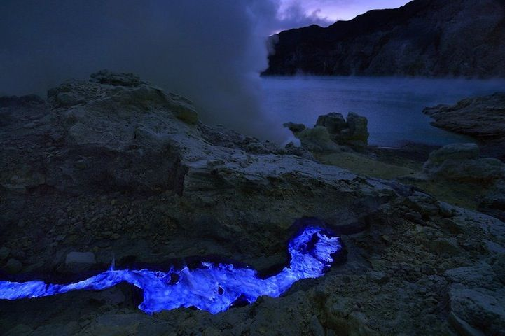 Indonesian volcano Kawah Ijen spews extremely dangerous lava with an extremely high sulfur content that glows a bright blue at night filling the sky with its glow