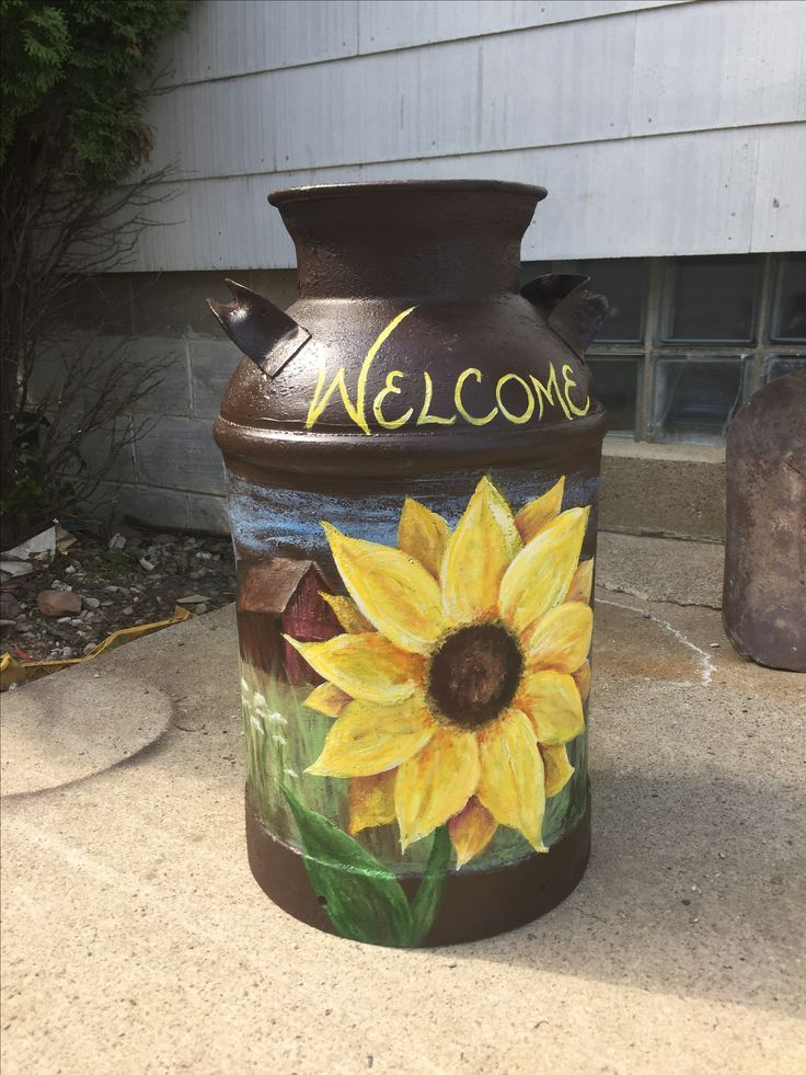 Sunflower with barn painted milk can