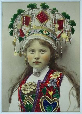 Woman in national costume and bridal crown, HardangerHardanger, a traditional district in the western part of Norway, ca. 1921