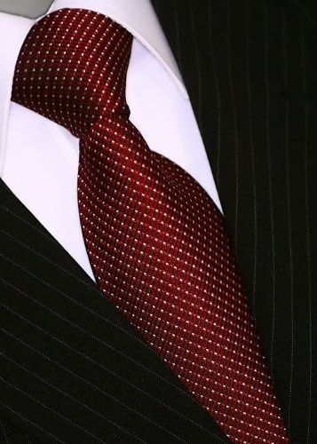 Spotted ties work great with almost any patterned suit or shirt because they stand out and don't contrast the main pattern.