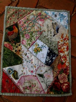 Lovely crazy quilt. I especially like how she used emboider to enhance the prints already on some of the fabrics.