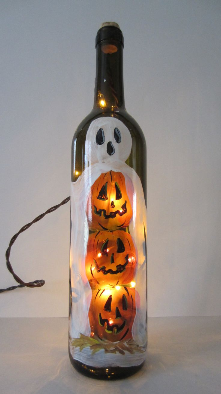 Jack-O-Lantern Ghost Lighted Wine Bottle. $20.00, via Etsy.