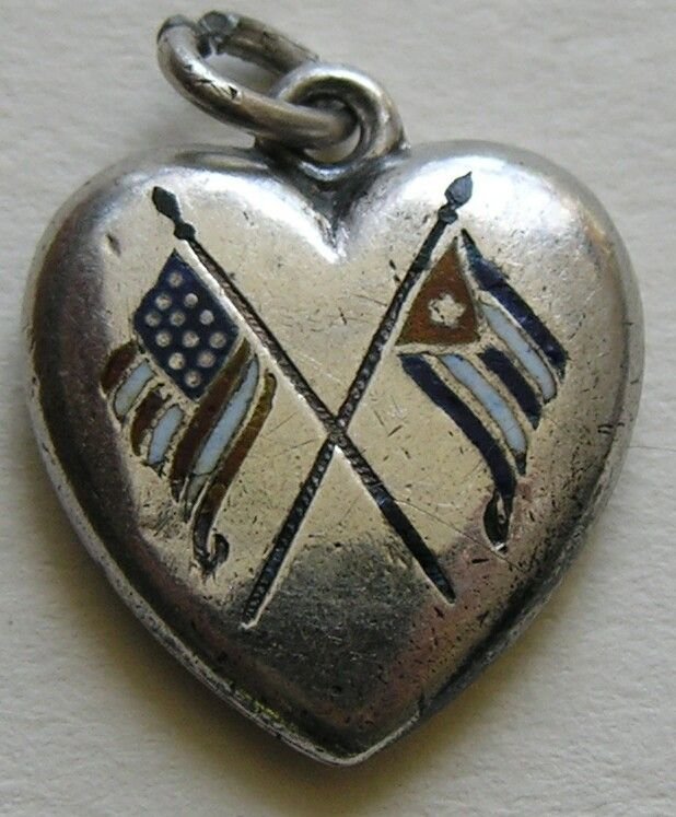 """Antique Spanish American War Enameled Flags Sterling Heart Charm This interesting antique enameled heart charm features both the American and Cuban flags and was most likely made to commemorate the Unites States' victory over Spain in the Spanish-American War.  After loosing the war, Spain signed the """"Treaty of Paris"""" in 1898 and recognized Cuba's independence."""