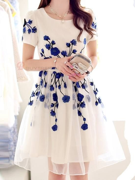 Ivory dress with blue floral detail at waist and sleeves