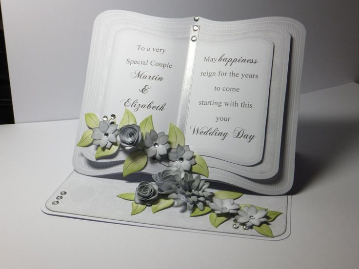 (Ref:D21) Easel card 18.5cm x 15cm. Card in grey & white, ideal for weddings, anniversaries and birthdays. Bookeasel card design and background paper download from Clipart Fairy. Flowers made using various dies in my collection. Edges inked with memento London Fog.