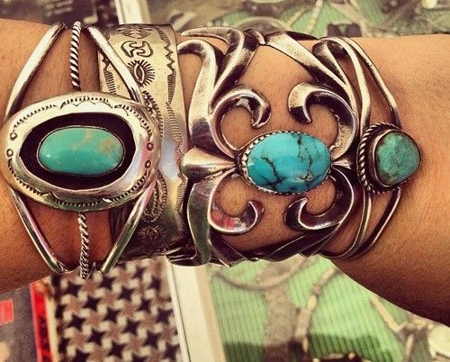 Turquoise bracelets. The one on the left appears to be the work of Teddy Goodluck.