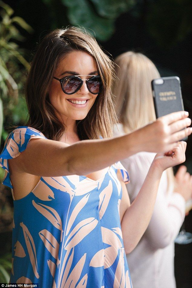 Selfie time! Olympia Valance donned a pair of dark shades as she posed beaming for a selfie at an intimate dinner she hosted for family and friends to showcase her summer style
