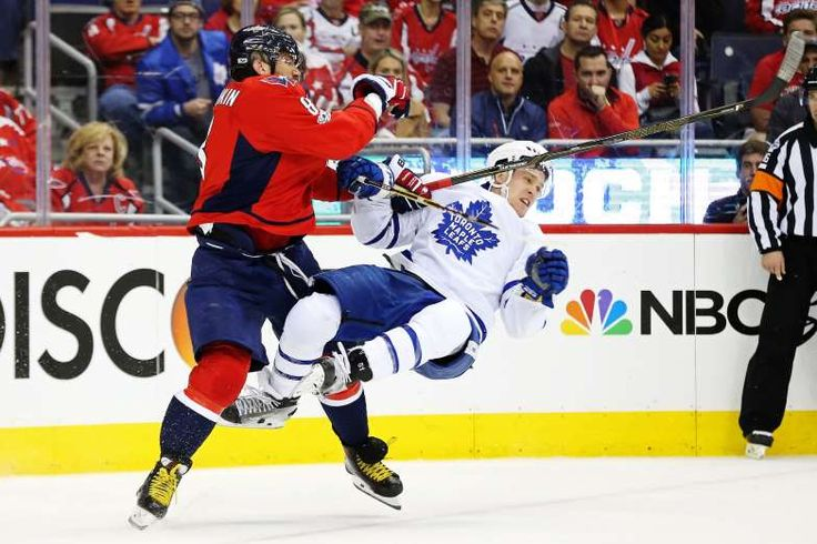 HIT HIGH:    Washington Capitals left wing Alex Ovechkin checks Toronto Maple Leafs defenseman Jake Gardiner in the first period in game five of the first round of the 2017 Stanley Cup Playoffs at Verizon Center on April 21.