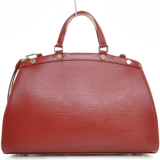 This is an authentic LOUIS VUITTON Epi Brea MM with a Strap in Carmine Red.