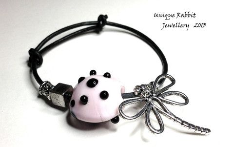 This cute little Polka Dot Dragonfly bracelet is one I have designed with an adjustable leather band to fit a variety of sizes.  The glass bead is hand made in the softest baby pink and it is teamed with a silver dragonfly, Tibetan silver large hole beads and a genuine leather band.   $22 plus $3 P
