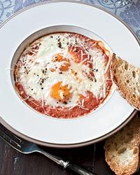Eggs Baked in Roasted Tomato Sauce // More Baked Breakfasts: http://fandw.me/jfO #foodandwine
