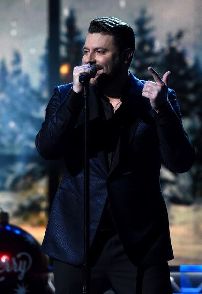 Chris Young Photos Photos - Singer-songwriter  Chris Young performs on stage during the CMA 2016 Country Christmas on November 8, 2016 in Nashville, Tennessee. - CMA 2016 Country Christmas