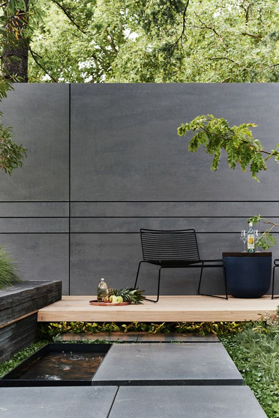 Concrete wall and modern landscape design. Great outdoor space!
