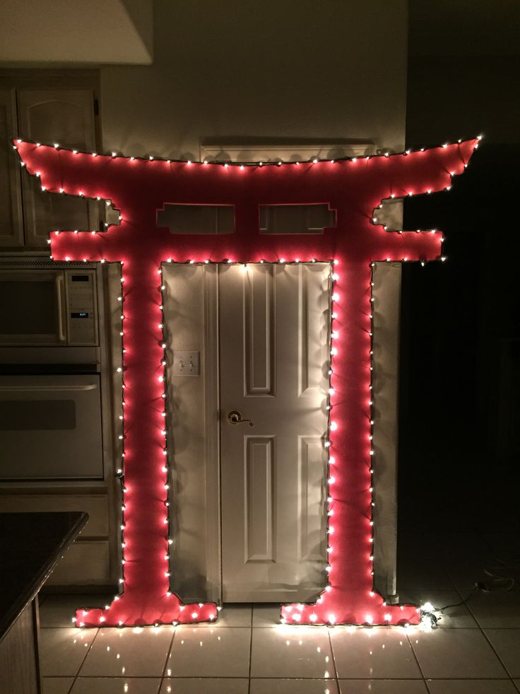 Magalie Sarnataro's . Japanese gate 7ft : foam board cutout, red paint outlined with lights  Space fillers for bleachers Asian themed party
