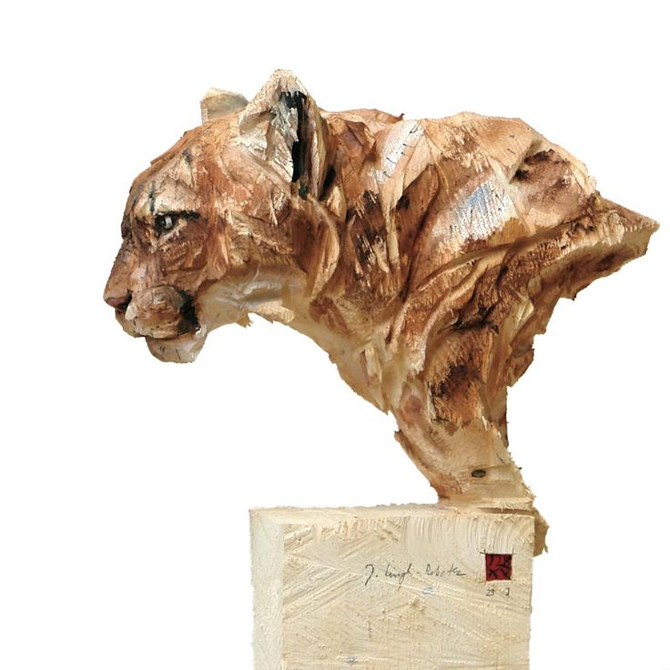 Buma' Solid block of wood (Epicia), sculpted with a chainsaw . Artist: Jürgen Lingl-Rebetez.