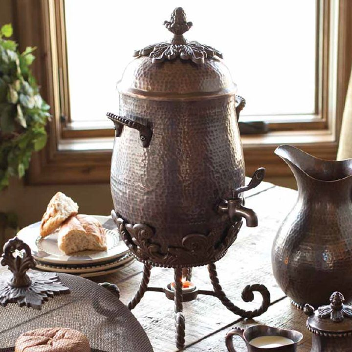 Antique copper enrobes this one gallon coffee carafe. Perfect for a Tuscan table.