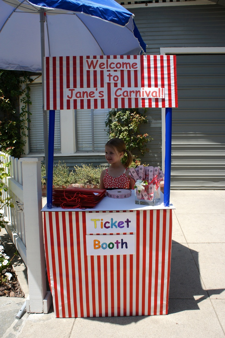 Ticket booth for carnival birthday party. We made it from a cardboard box on bottom, two gift wrap tubes, and a strip of cardboard on top, all covered with gift wrap. The surface of the booth is another piece of cardboard.