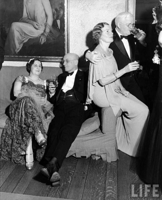 mr & mrs kirby  Formally dressed men & women at a Kentucky Derby party. Location: Louisville, KY, US Date taken: May 1937 Photographer: Alfred Eisenstaedt