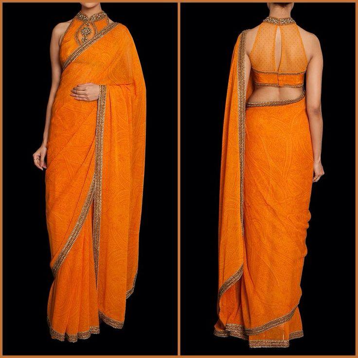 Orange silk sari with halter blouse by Ritu Kumar