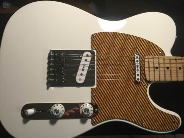 Up for grabs is an Arctic White Fender Partscaster built by Prima Custom…