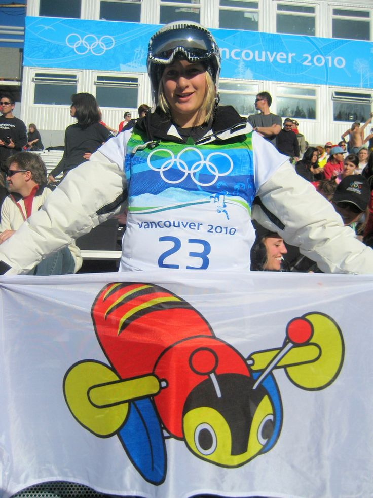 Rebecca Sinclair holding the flag of the No 1 Iconic toy of New Zealand at the 2010 Vancouver Olympics.