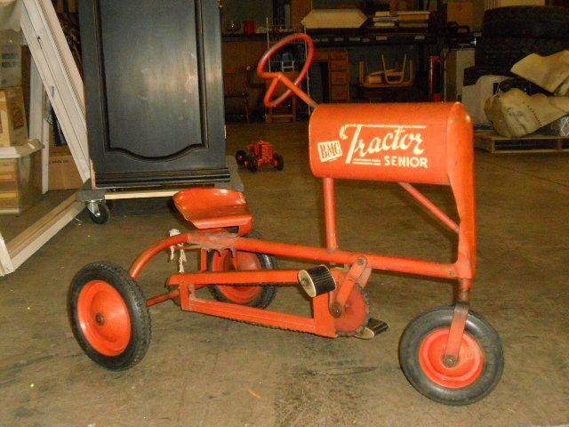 Looks like my Allis Chalmers CA 'big girl' tractor. I'd love to put this on my porch!